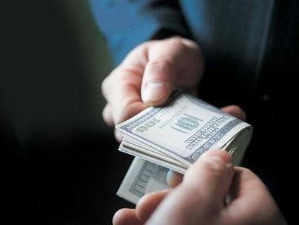 Волинянка хотіла підкупити прокурора за 100 доларів США