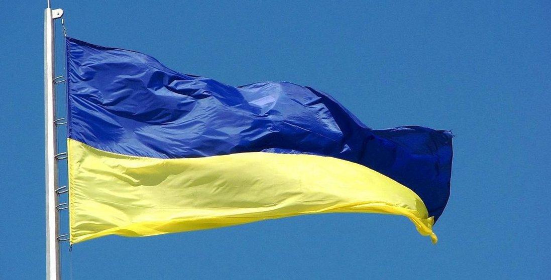 «Побив» українським прапором: активісту «світить кримінал» зазбиту кепку поліцейського
